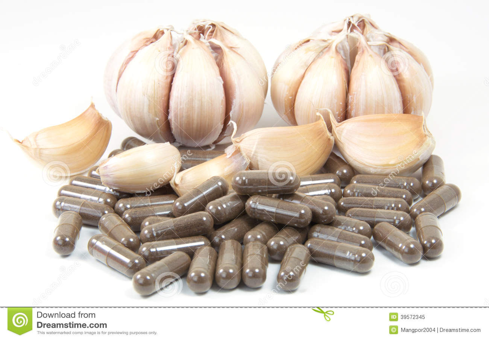Växt- kapslar för vitlök, muntlig medicin, alternativ medicin som isoleras på vit bakgrund.