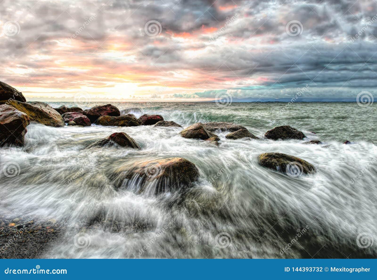 Vågor för Seascapesolnedgånghav
