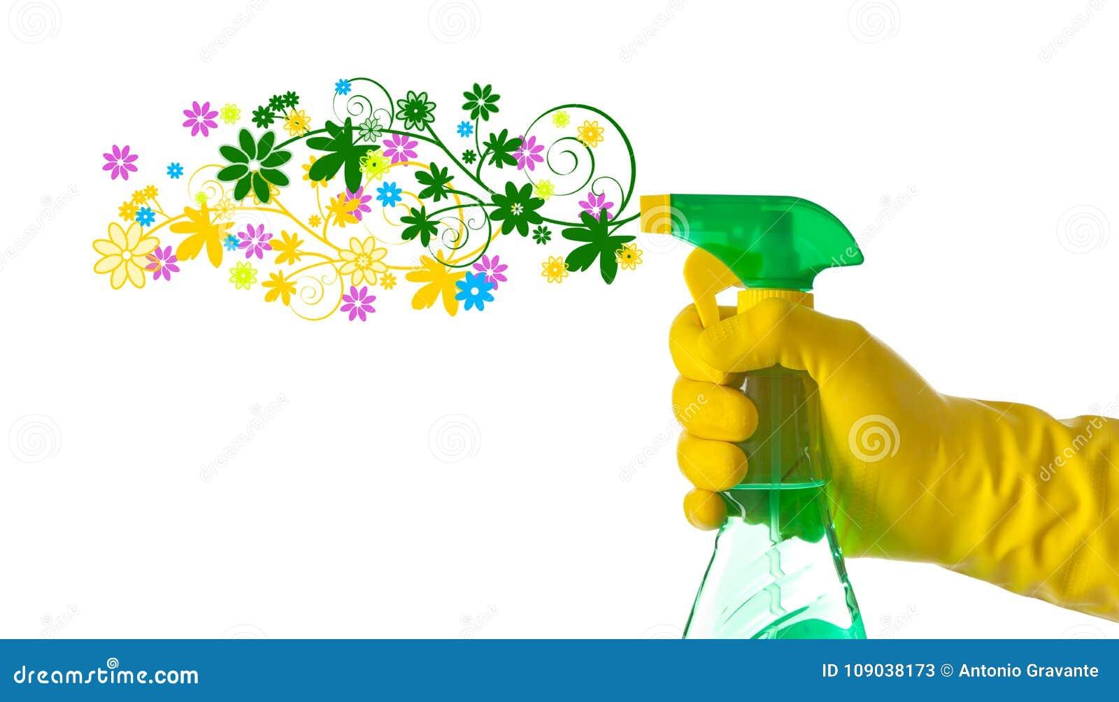 Vårlokalvårdbegrepp Blom- tvättmedel som besprutas av en hand med