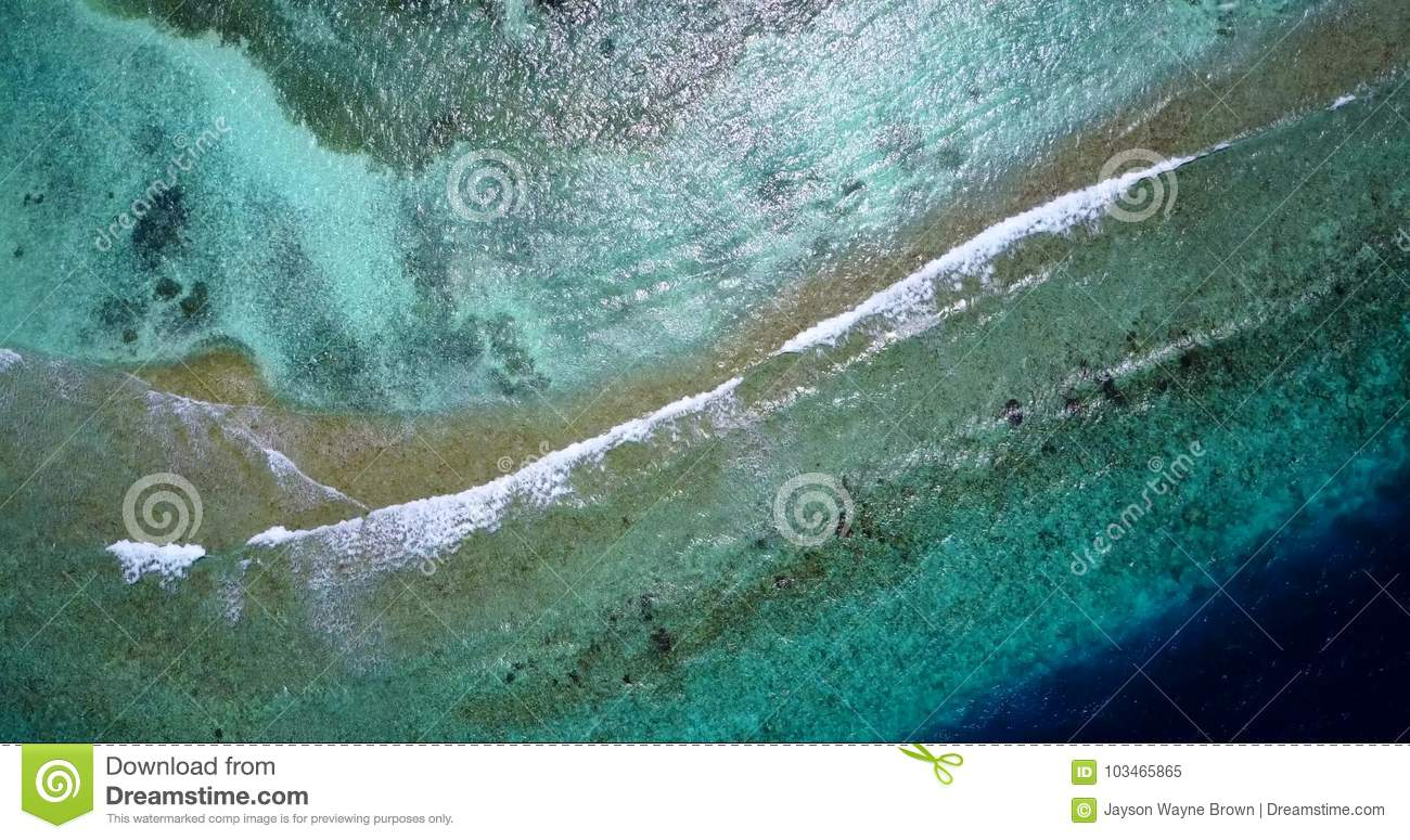 V13236 waves water texture breaking and crashing with drone aerial flying view of aqua blue and green clear sea ocean