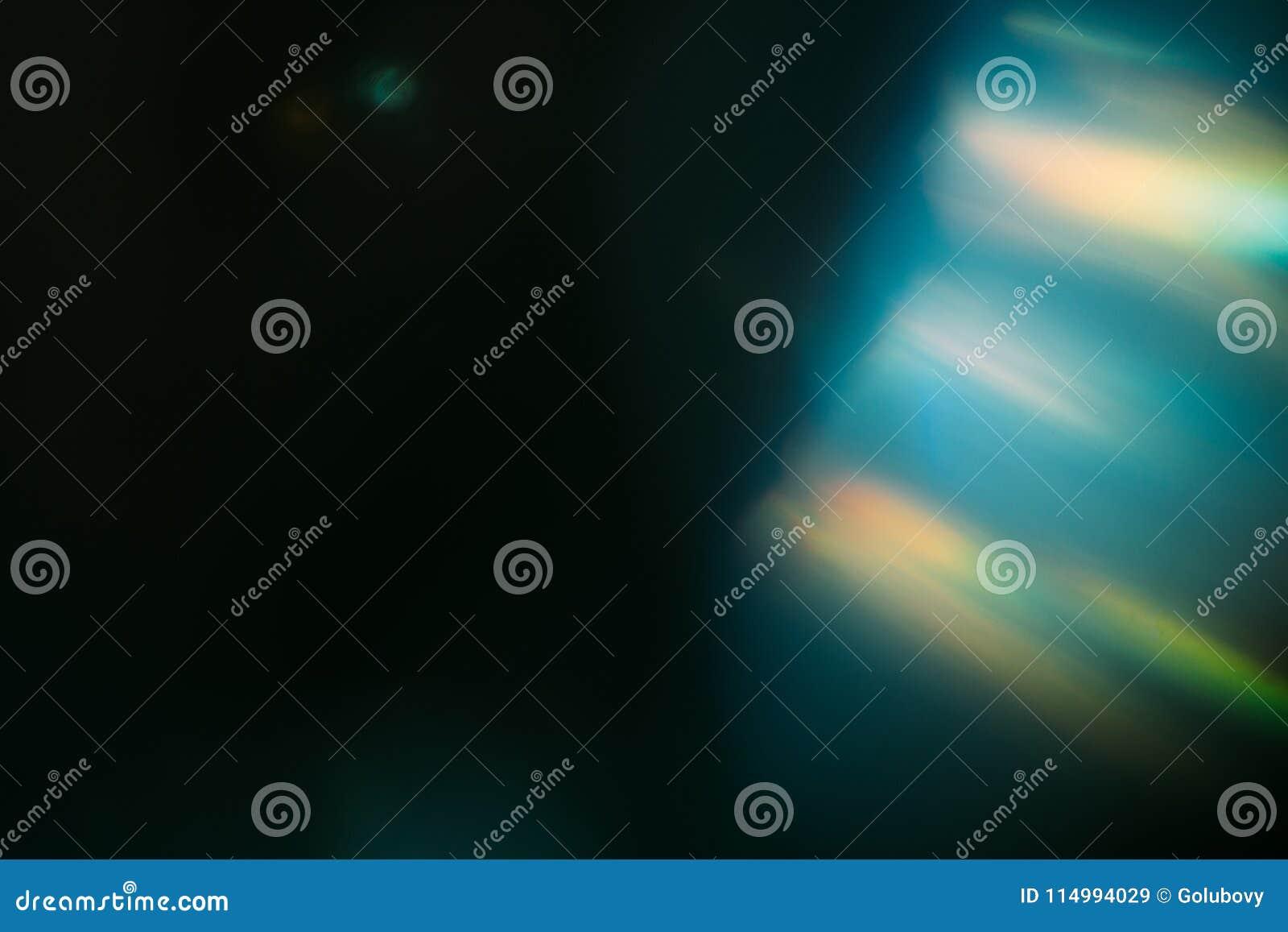 Vaag defocused gloed van de stralen de lichte lens
