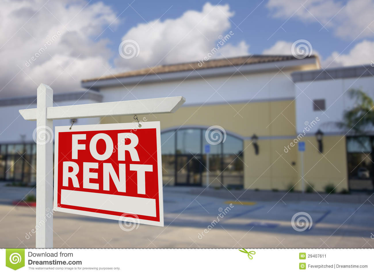 Vacant Retail Building with For Rent Real Estate Sign