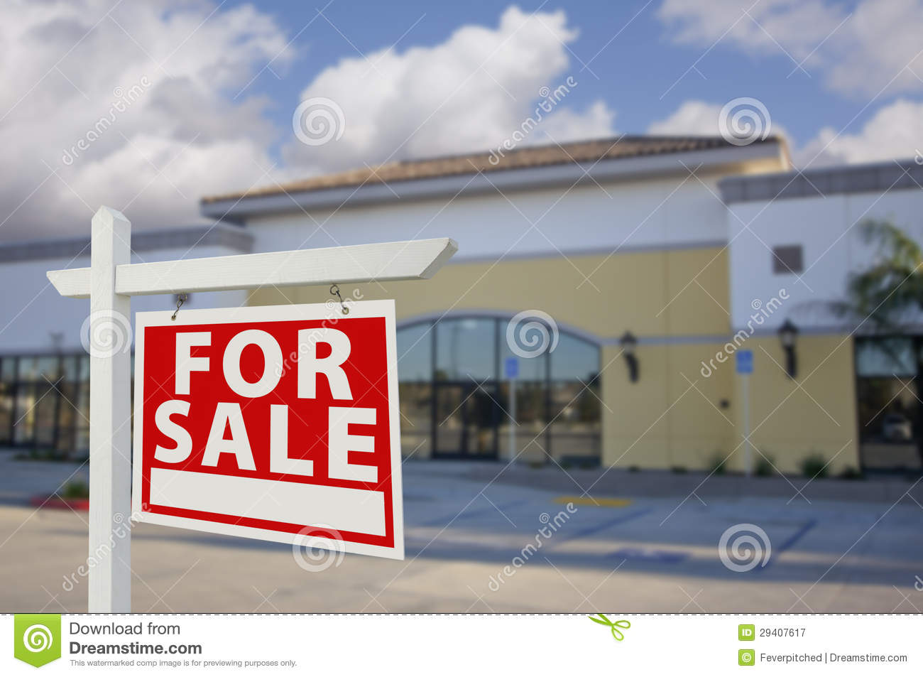 Vacant retail building with for sale real estate sign for Building an estate