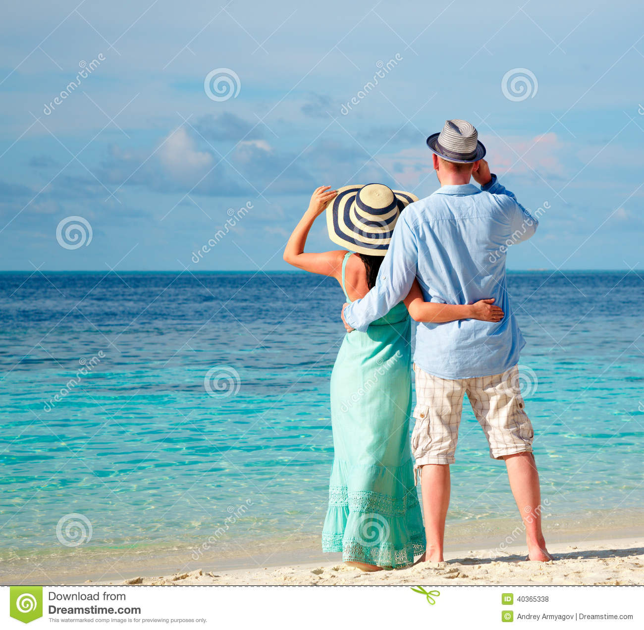 Vacation Couple Walking On Tropical Beach Maldives. Stock