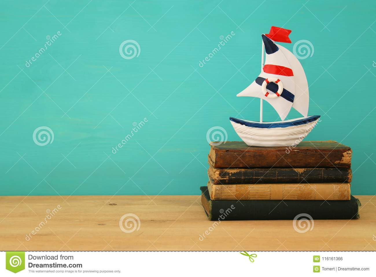 Vacation And Summer Image With Boat And Antique Books Over Wooden