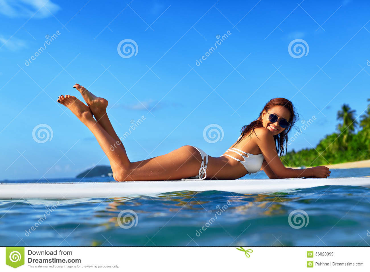 Vacation Travel. Summer Relax. Healthy Woman In Water. Recreational Sports.