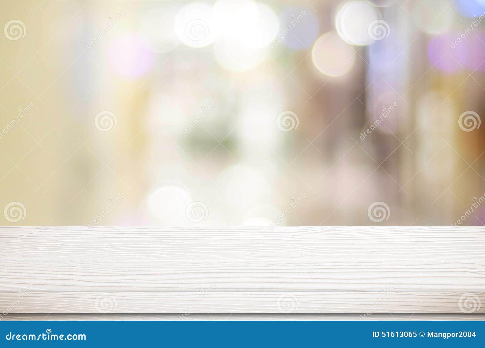 Vacie la tabla blanca y el fondo borroso del bokeh de la tienda, di del producto