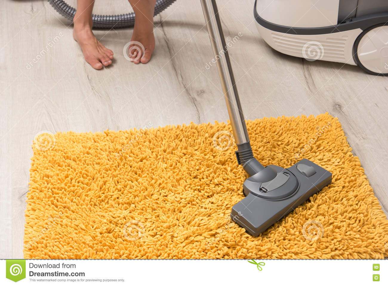Woman Legs With Vacuum Cleaner Cleaning Floor Stock Photo