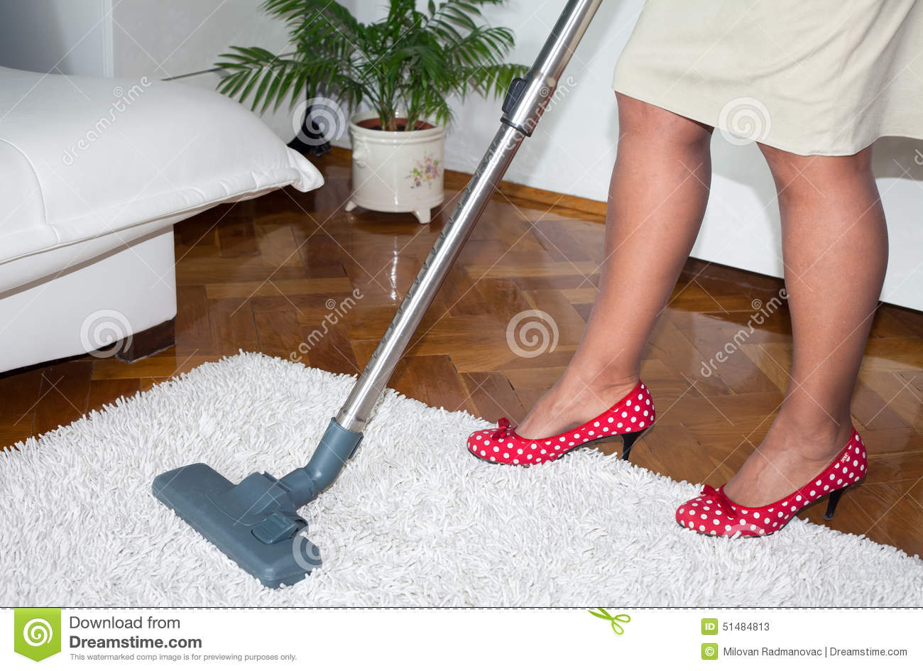 Lady Hoovering Carpet In The Living Room