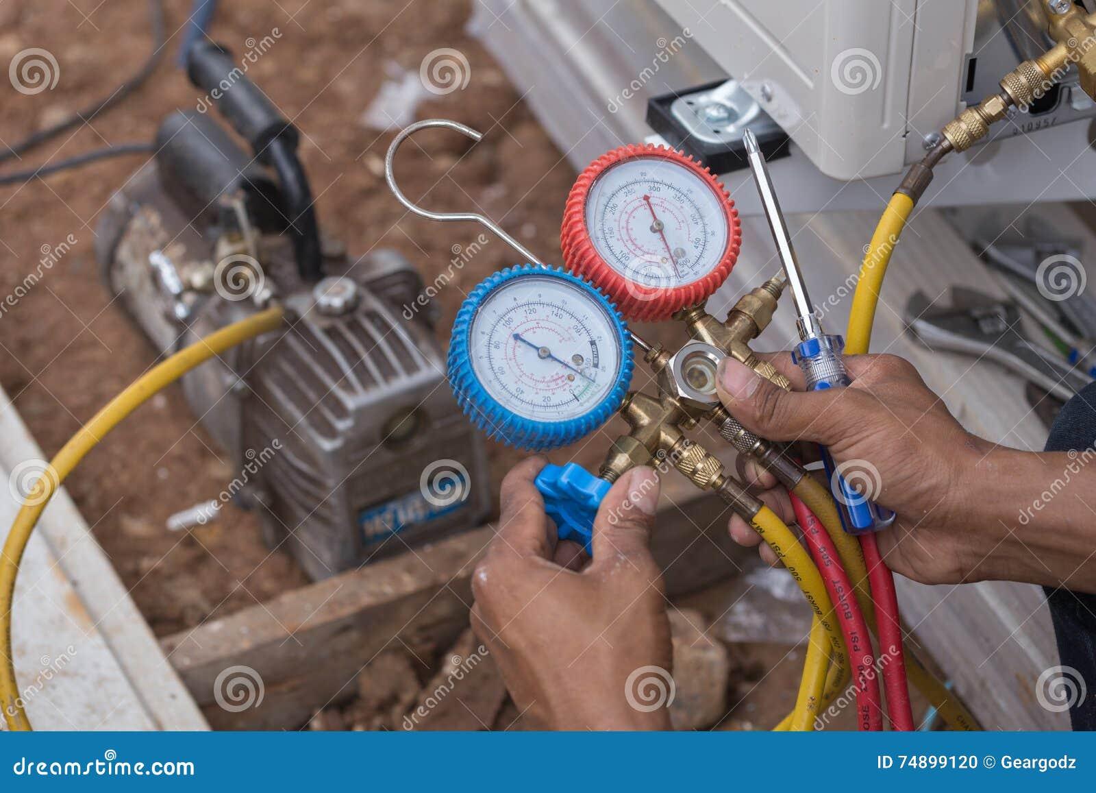 Vacuum pump evacuates air from the air conditioner