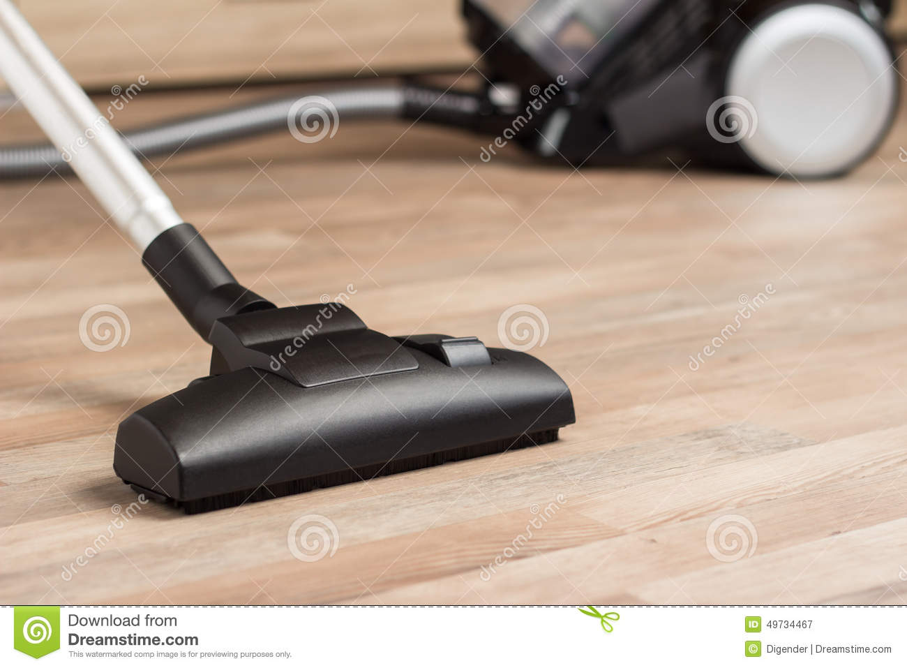 Vacuuming A Thick Pile White Carpet Royalty Free Stock