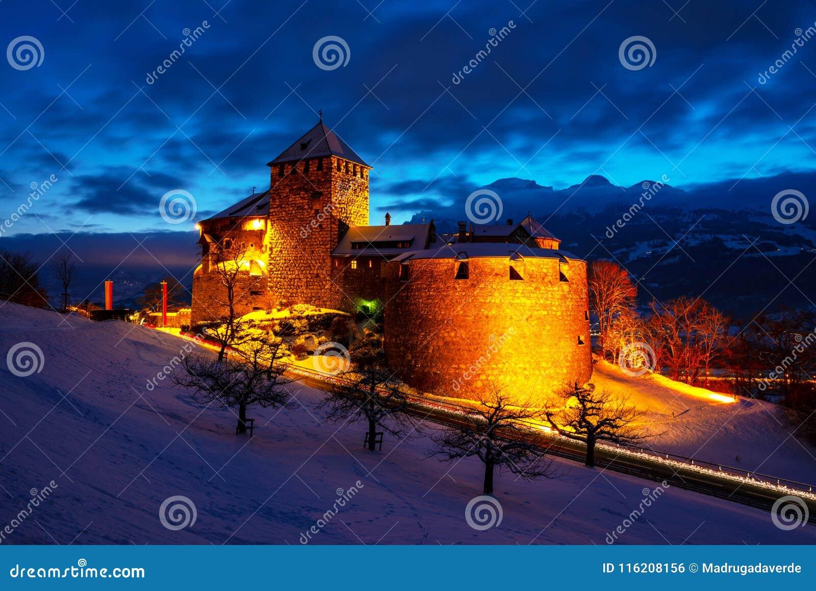 Illuminated castle of Vaduz, Liechtenstein at sunset - popular landmark at night