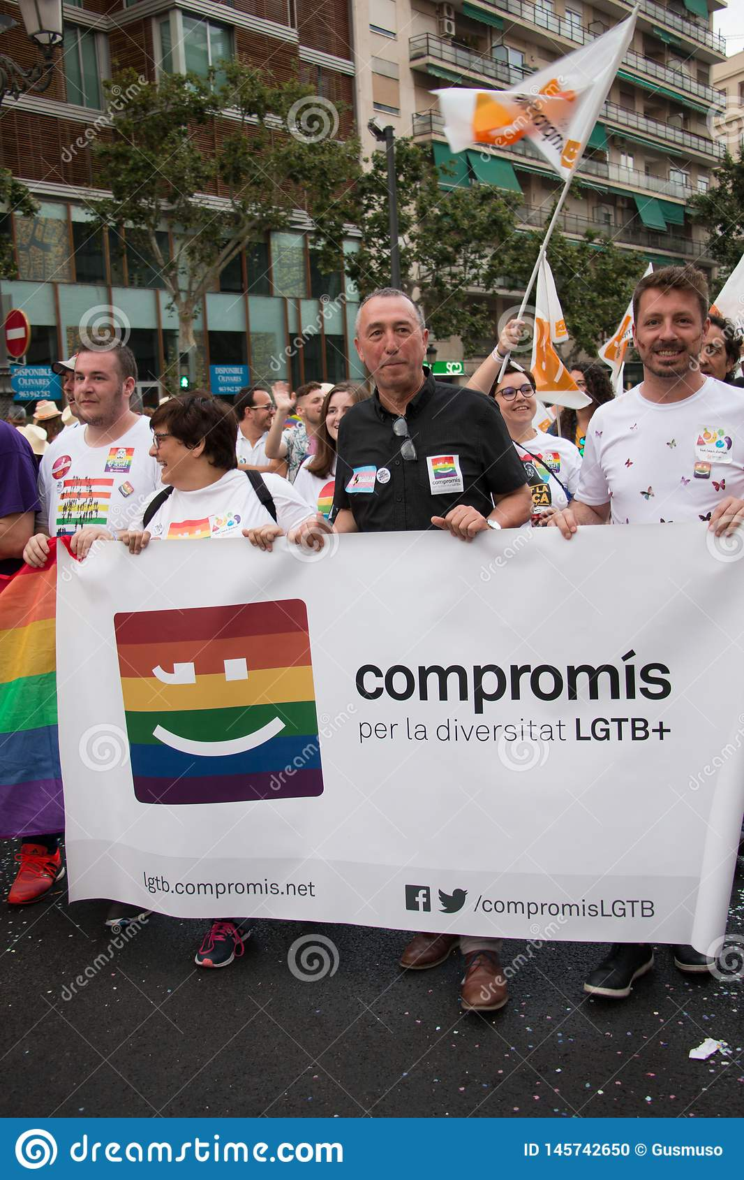 Valencia, Spain - June 16, 2018: Joan Valdoví and part of his political group Compromís with a banner on Gay Pride Day in Valenc