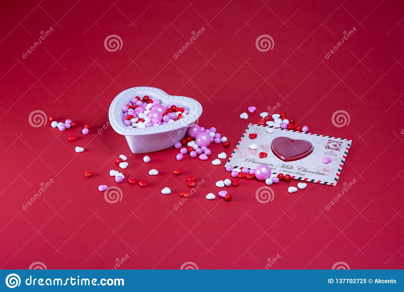 Valentine candy on a red background