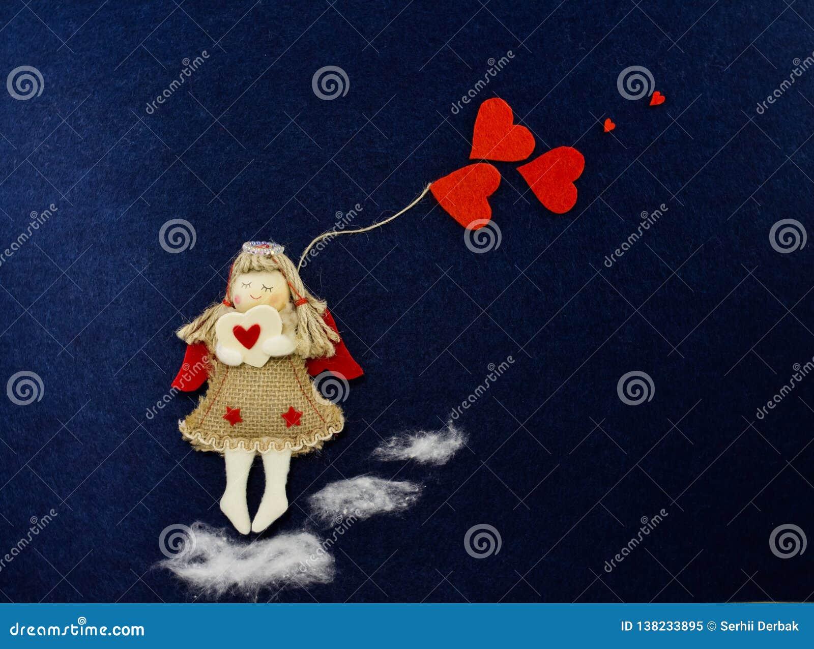 Valentine dans l image d un ange avec les coeurs rouges