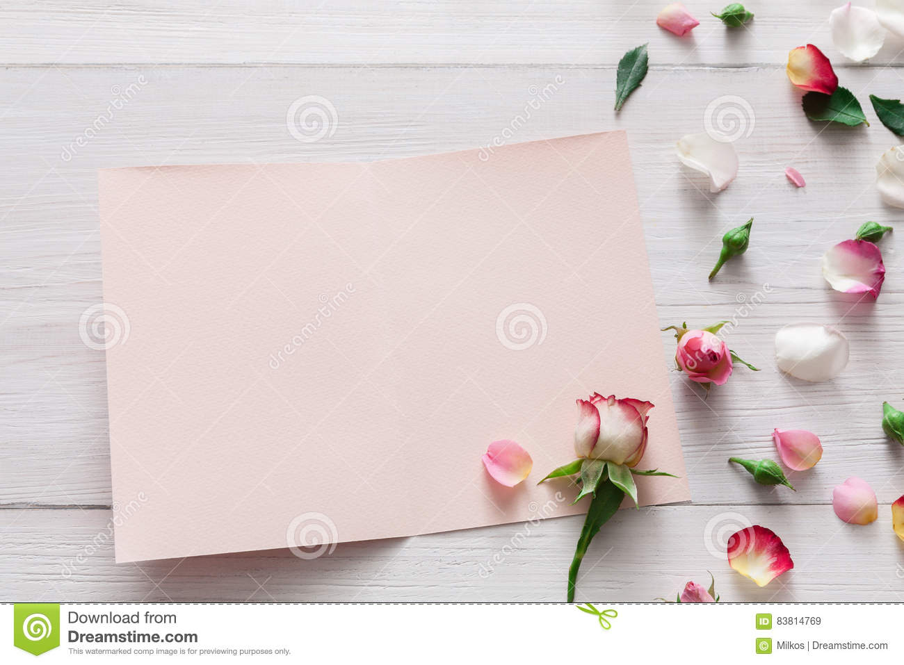 Valentine day background, rose flowers and card on white wood