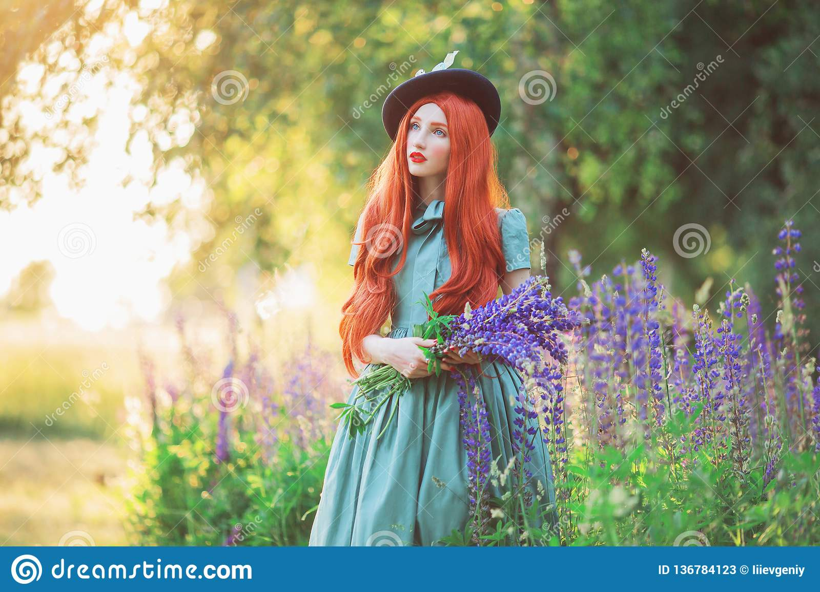 Valentine Day background. Spring blooming lupine flower garden. Perfect  lady with red lips in dress. Summer hat. Perfect floral wall. a0211e43e8ed
