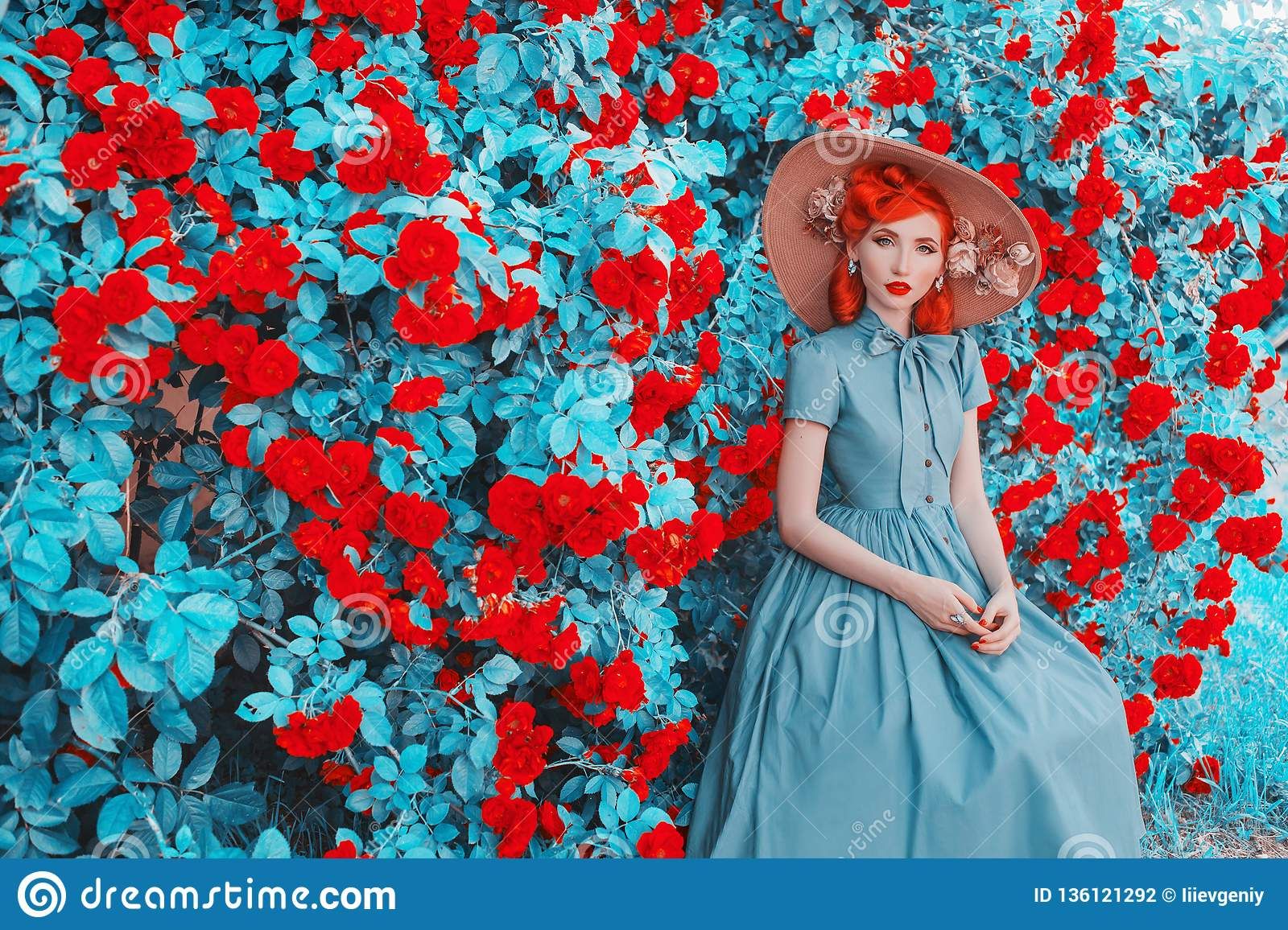 Valentine Day background. Spring blooming rose flower garden. Perfect lady  with red lips in dress. Summer hat. Perfect floral wall. 67dd83011497