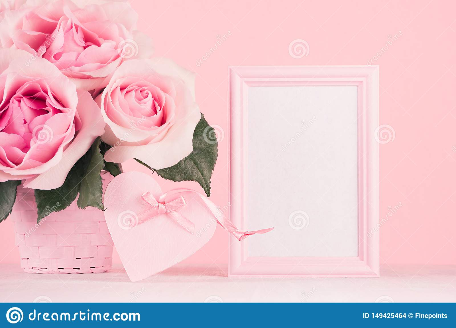 Valentine days background - elegant pastel pink roses bouquet, decorative heart with ribbon, blank frame for advertising on white.