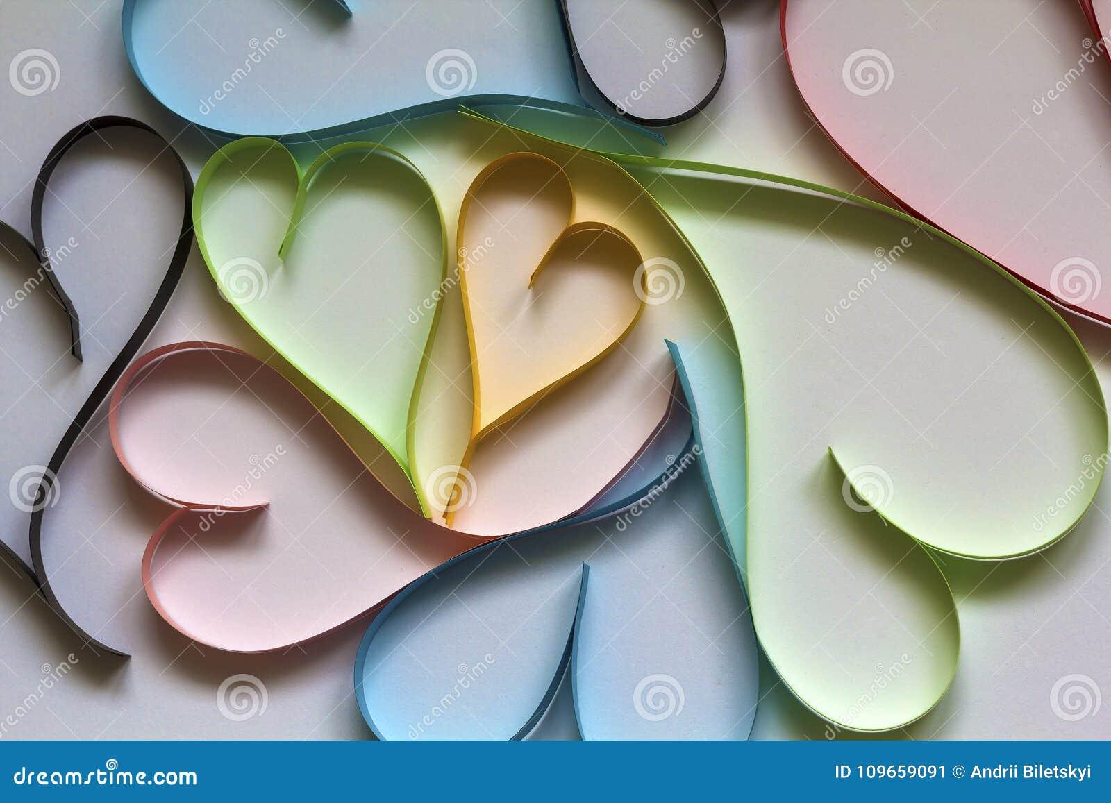 Valentine& x27; el fondo del extracto del día de s con colorido de papel cortada oye