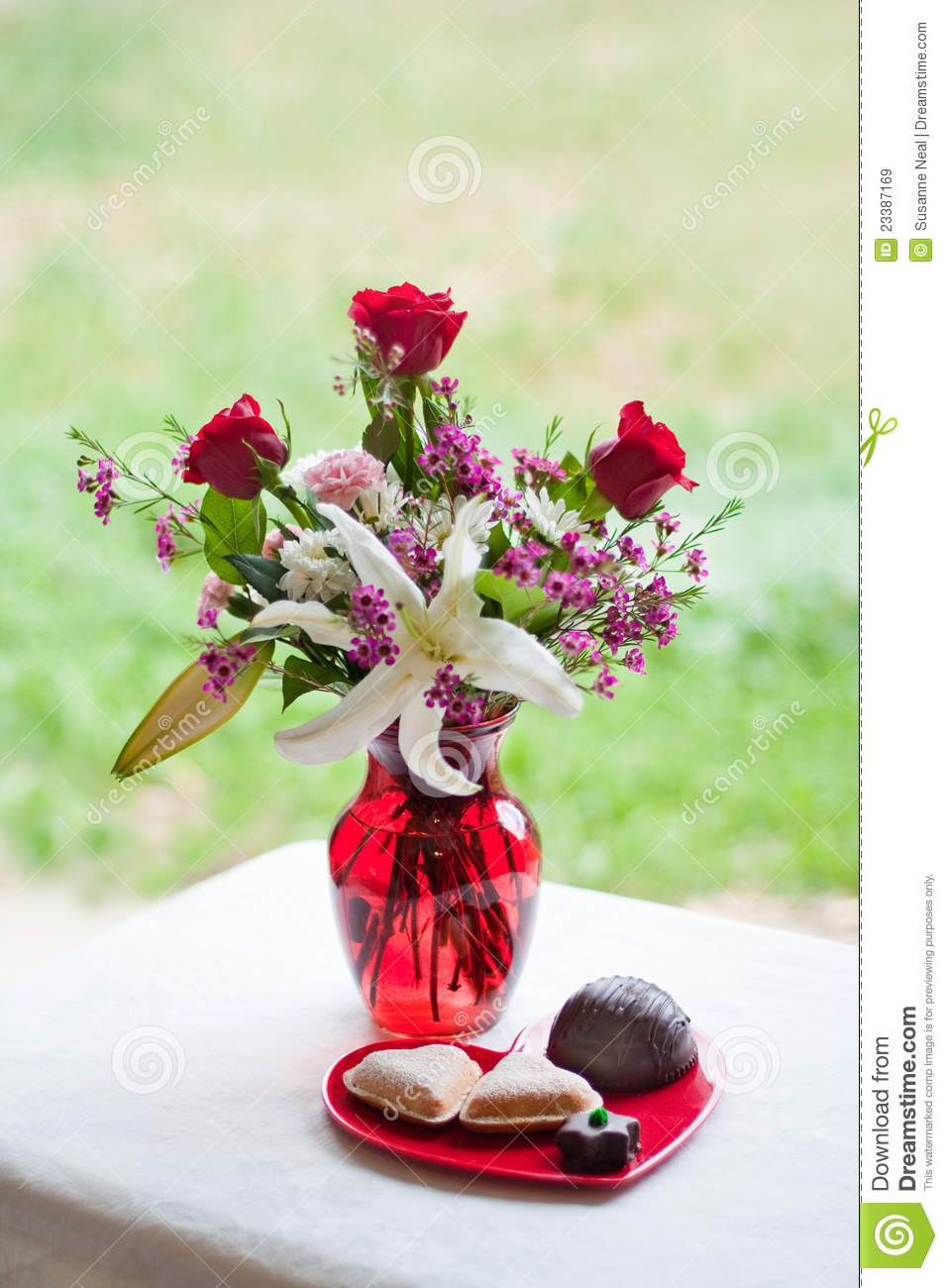 Valentine Flowers In Red Vase And Sweets Royalty Free