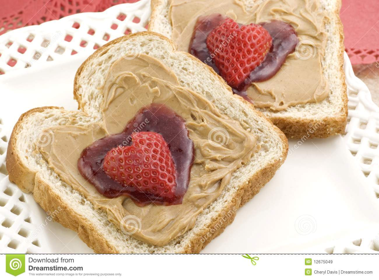 peanut butter and strawberry jam in a heart shape, topped with a heart ...