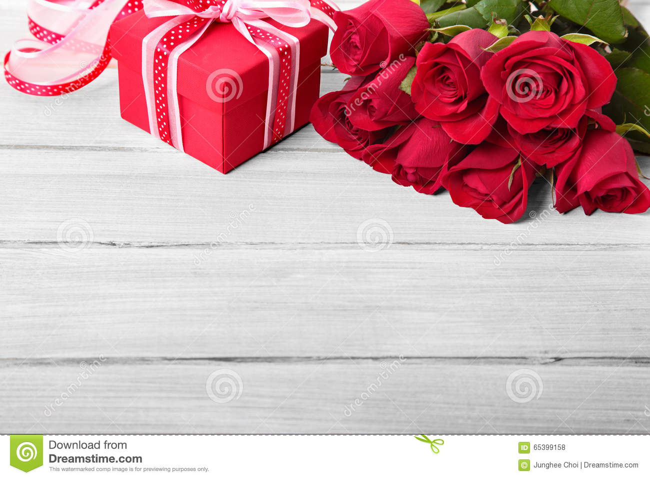 Valentine Roses And Gift Box On White Wood Copy Space Stock Photo