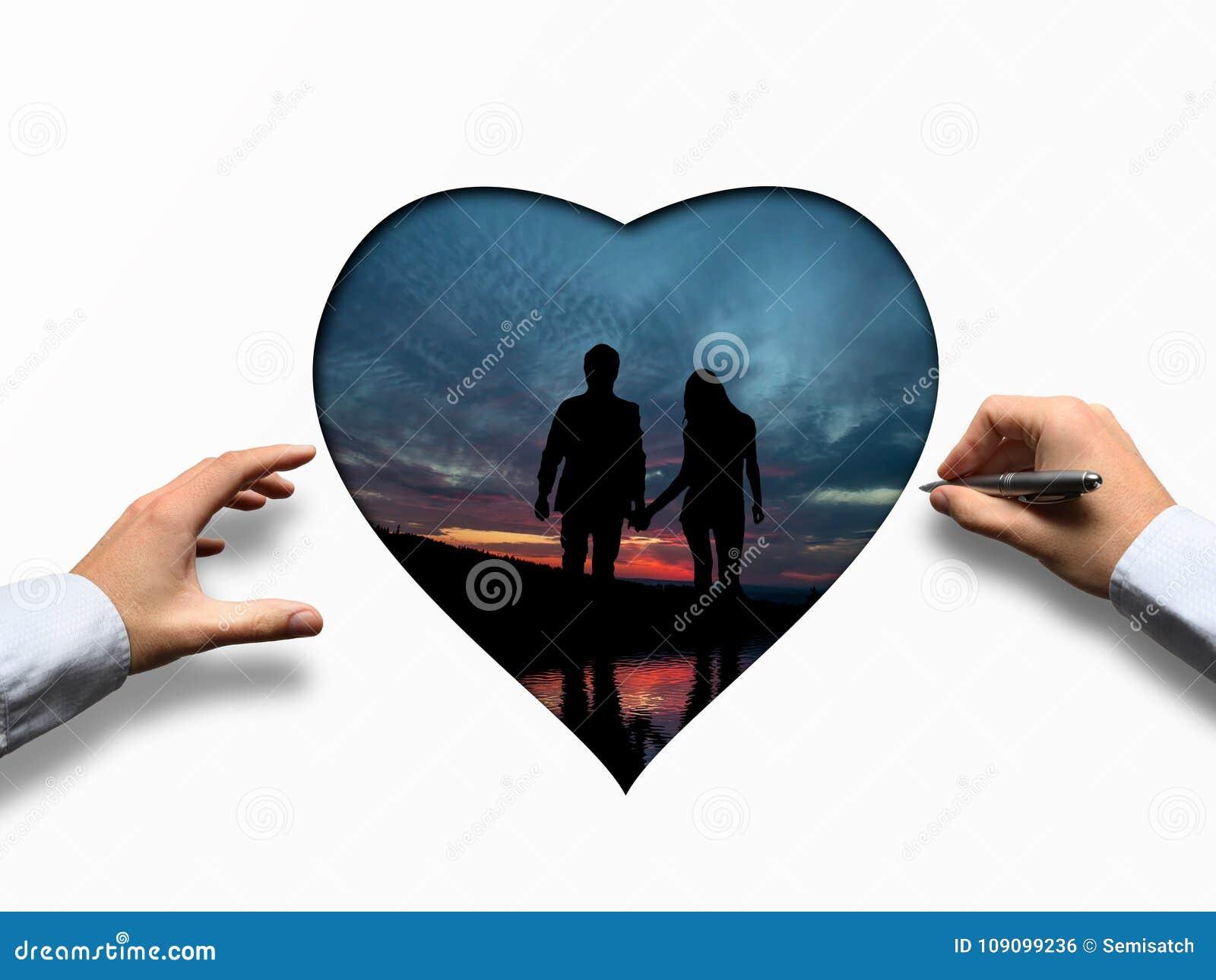 Valentine& x27; s与心脏的天在日落期间的概念和夫妇