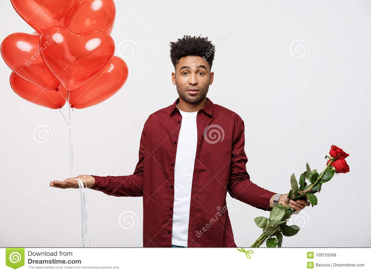 Download Valentine`s Day: African American Man Holding Red Rose And Balloon With Disappointed Expression. Stock Photo - Image of african, camera: 109755008