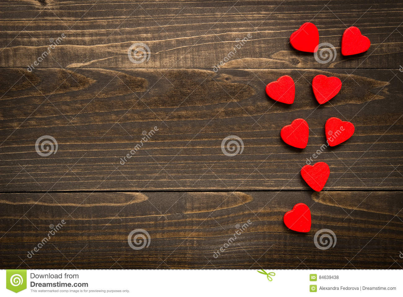Valentine`s day background. Red hearts on the wooden desk