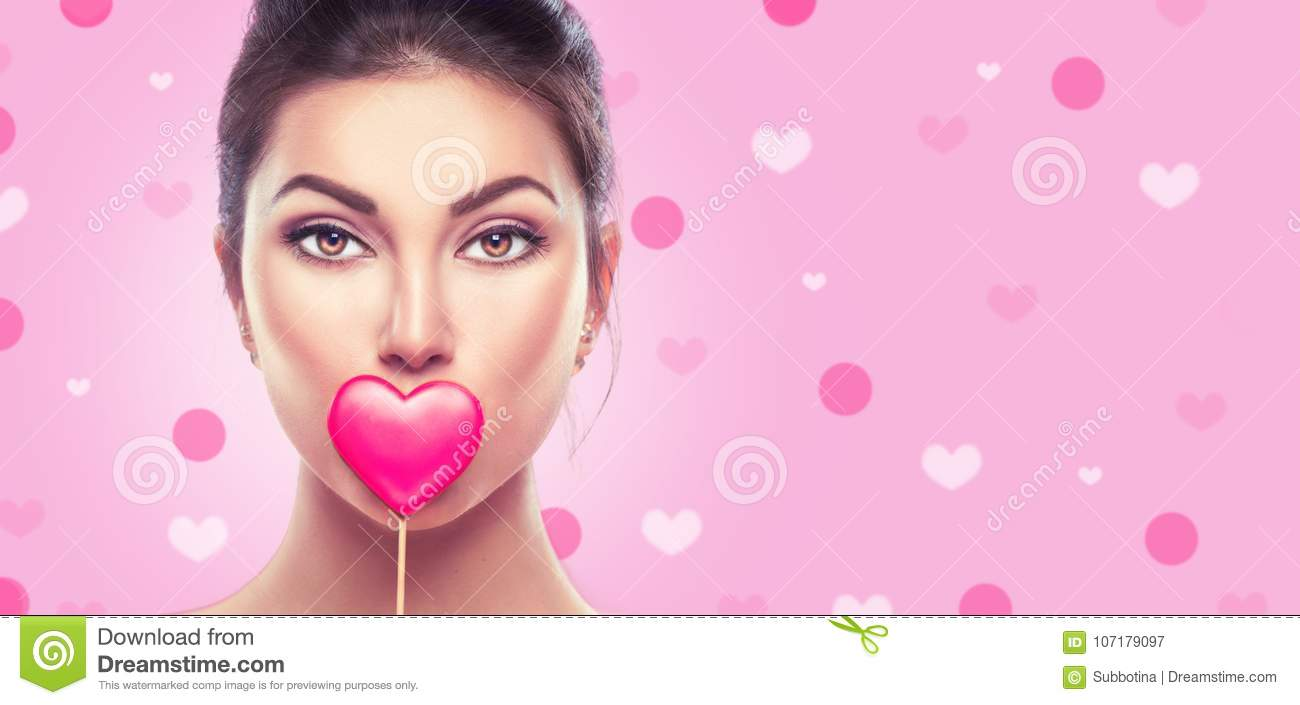 Download Valentine`s Day. Beauty Young Fashion Model Girl With Valentine Heart Shaped Cookie Over Pink Stock Image - Image of advertising, lips: 107179097