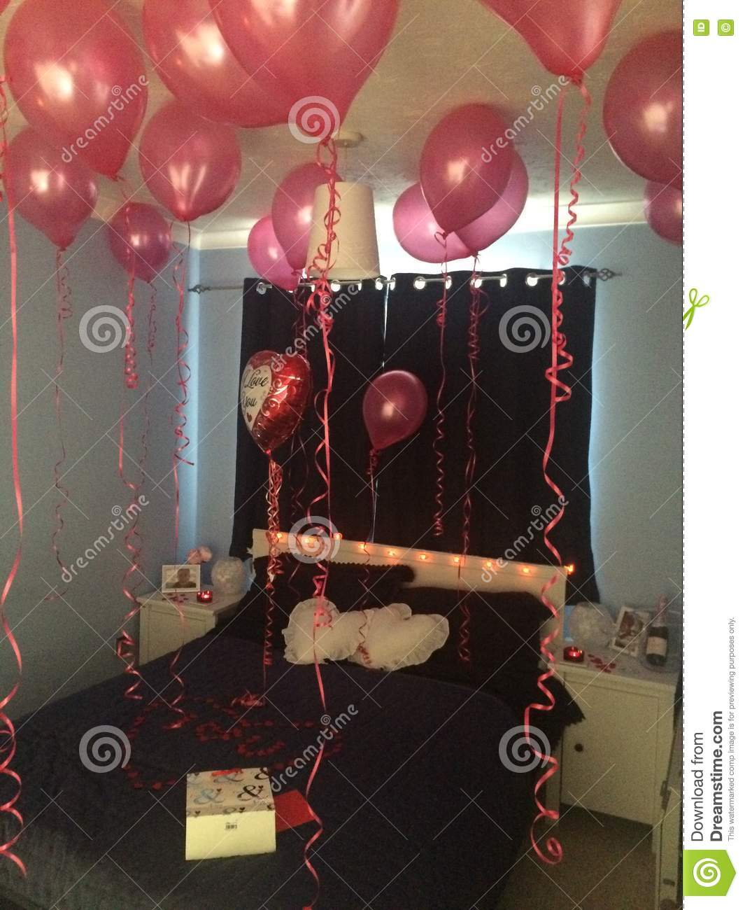 Valentine's Day Bedroom Decorated With Red Helium Balloons