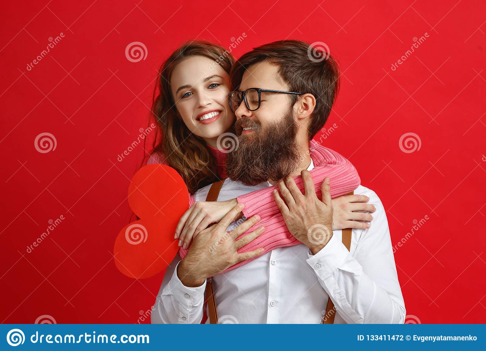 Valentine`s day concept. happy young couple with heart, flowers