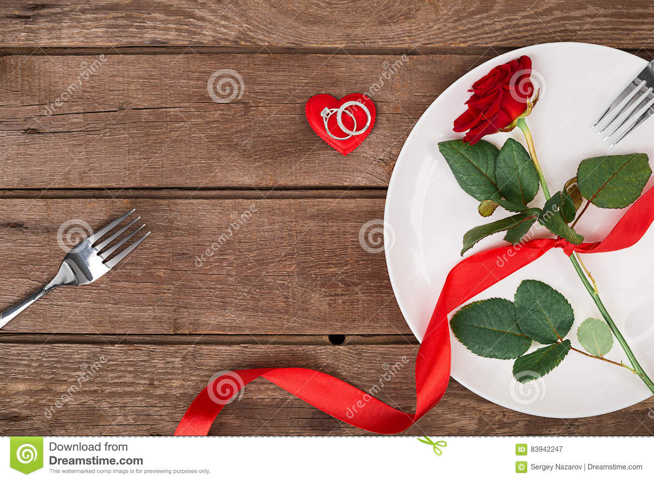 Valentine S Day Dinner Table Setting With Red Ribbon Rose Knife