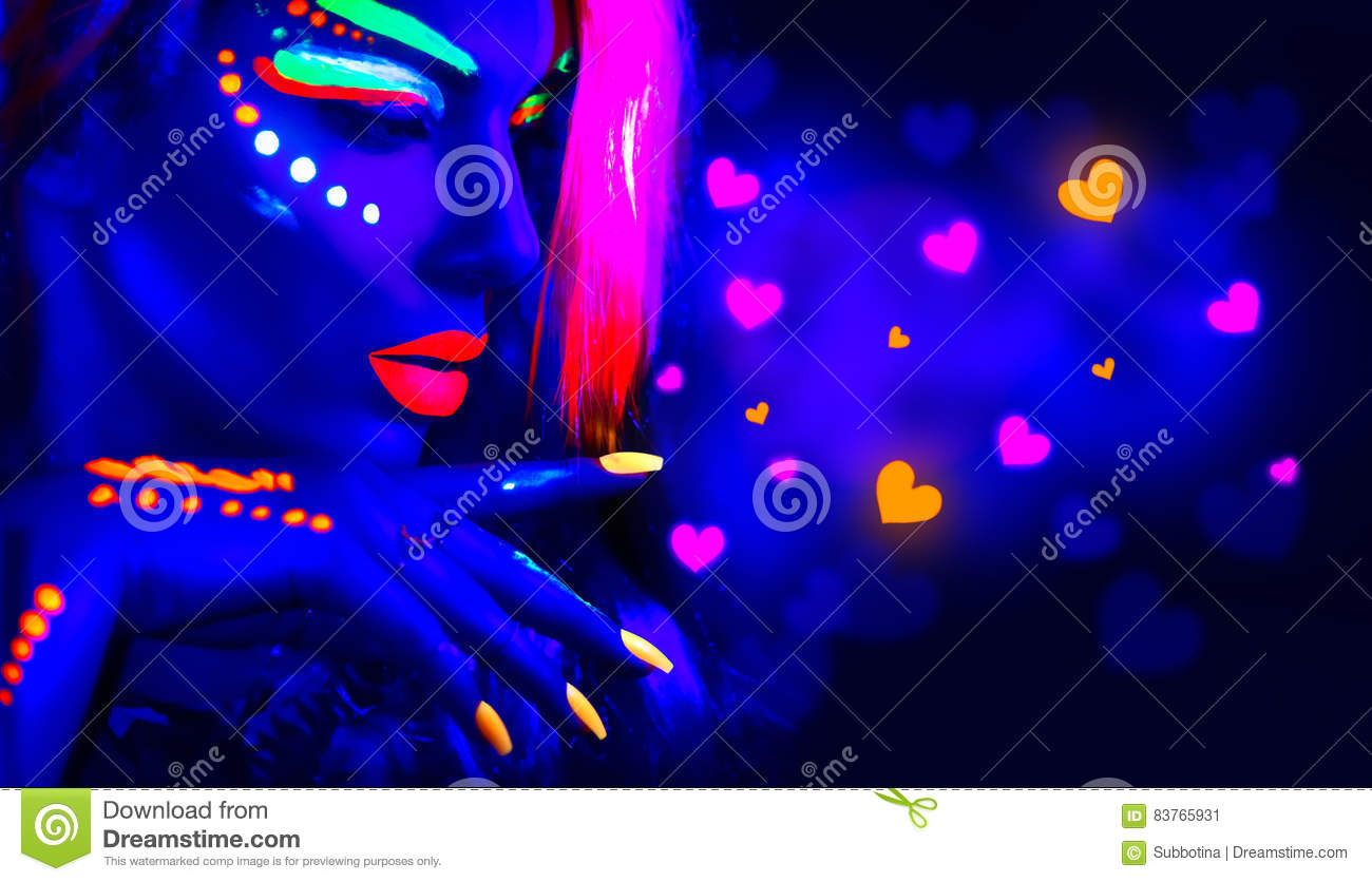 Valentine`s day disco party. Fashion model girl in neon light