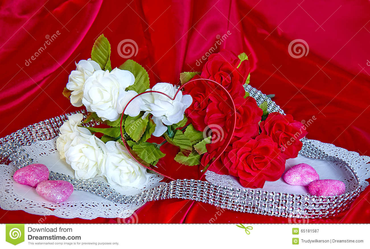 Valentines Day Flowerscandyheart Shape On Red Silk Stock Image