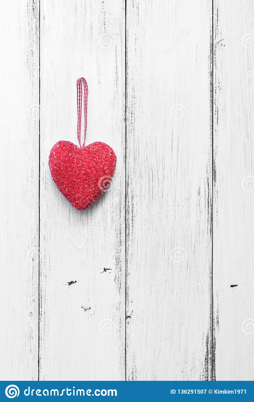Valentine`s Day. Red heart on a white wooden rustic background from boards. Top view, flat lay, copy space.Vertical frame
