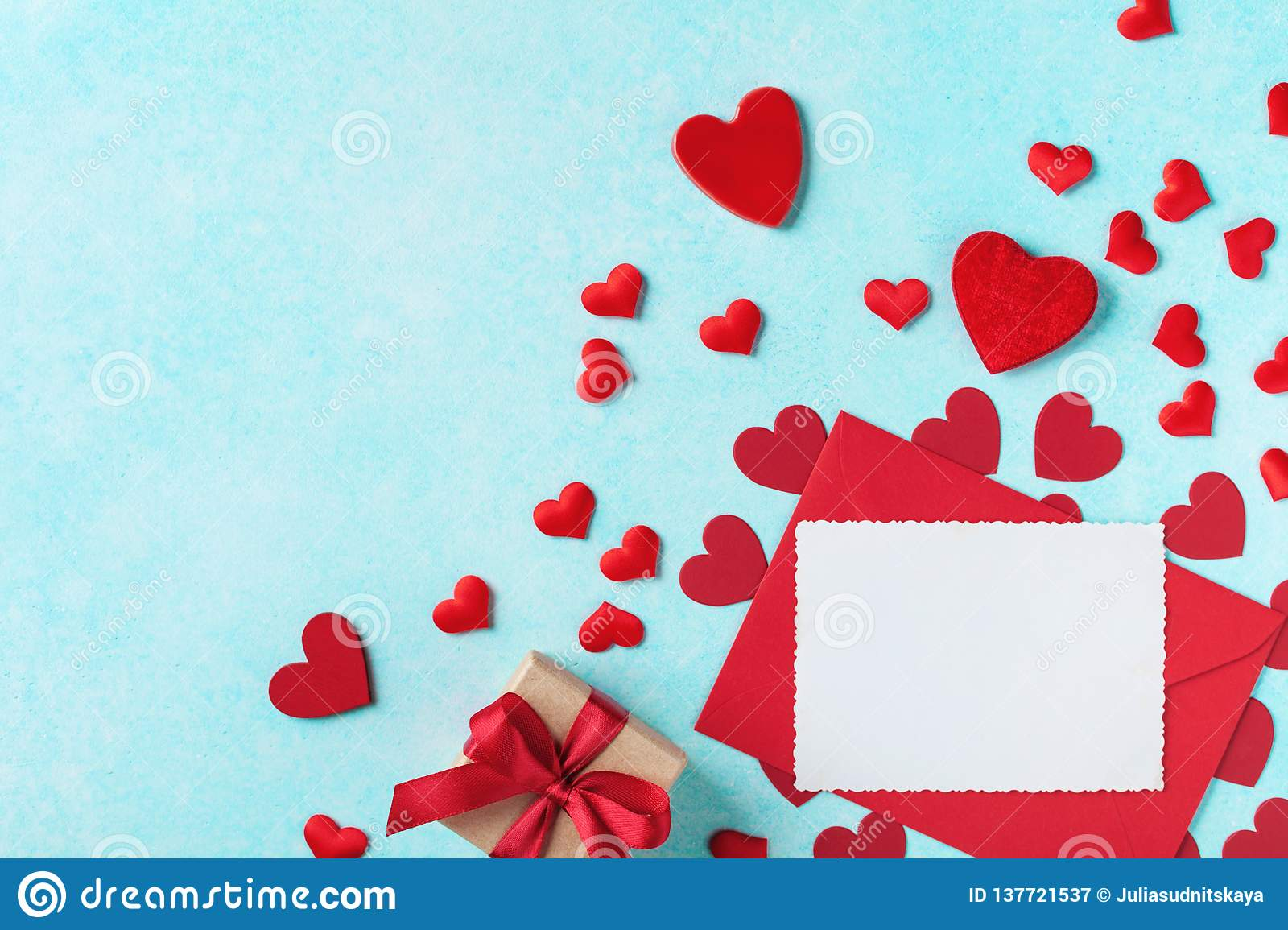 Valentines day background. Envelope, greeting card, gift box and red hearts for holiday message