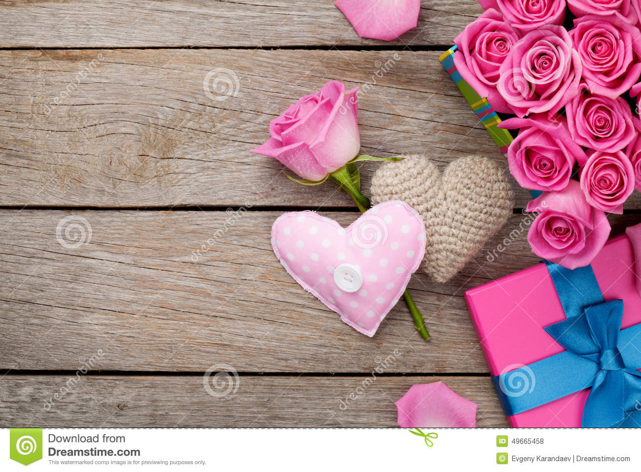 Valentines day background with gift box full of pink roses and h