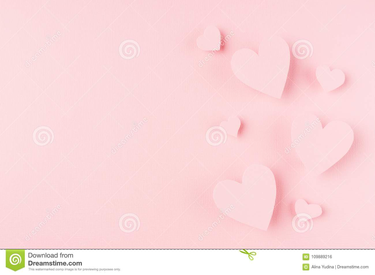 Valentines day background with hearts flying on pink paper, copy space.
