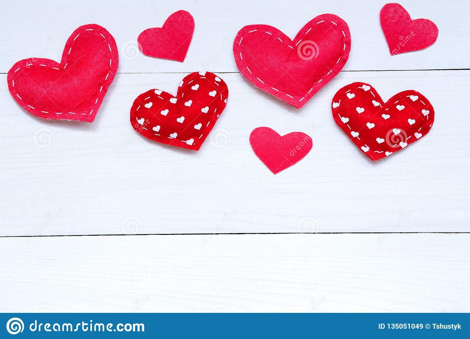 Valentines day background with hearts on the wooden table, top view