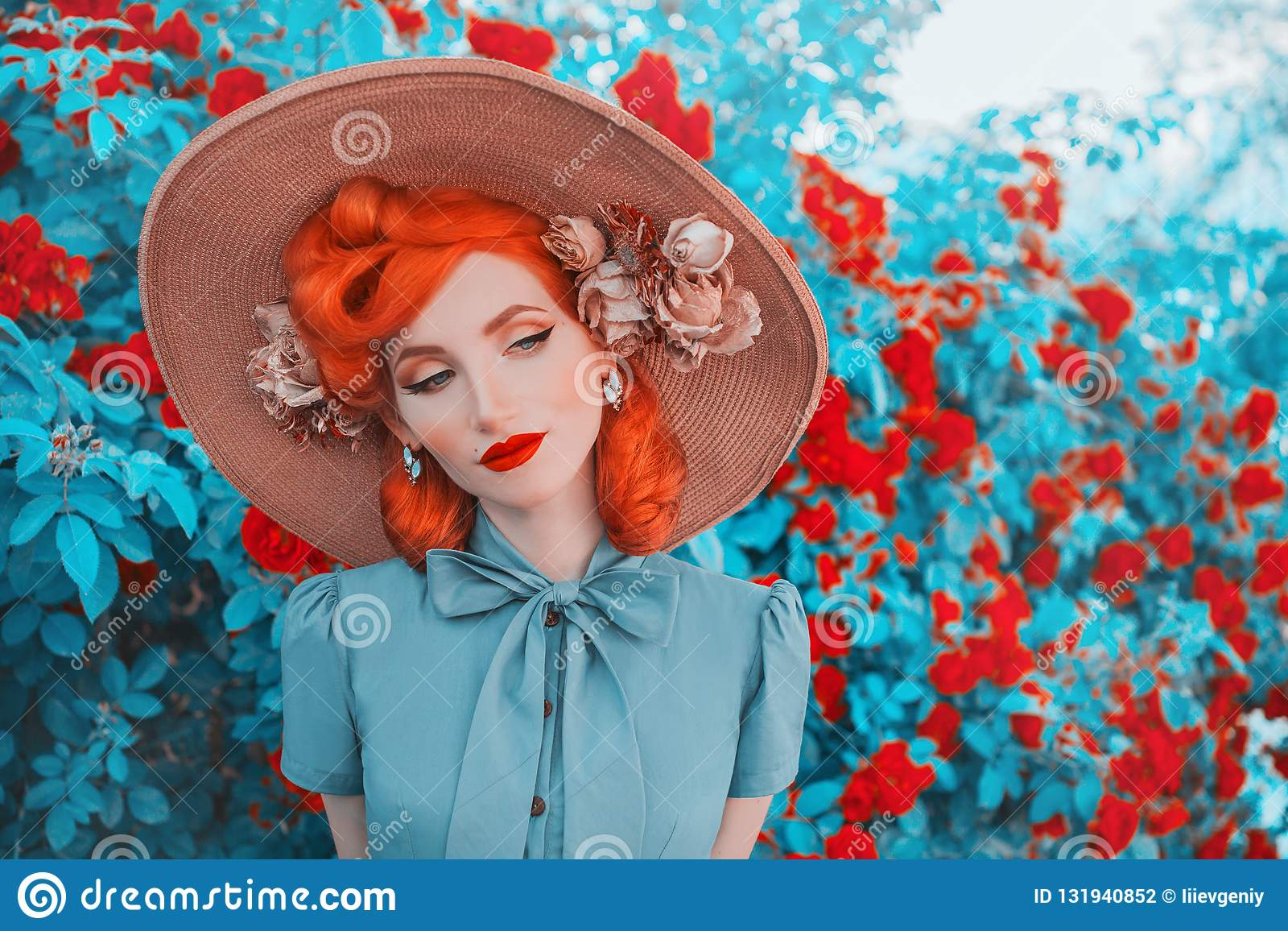 Valentines Day background. Vintage girl with red lips in awesome mint dress. Summer flowers aroma. Woman portrait. Awesome redhead