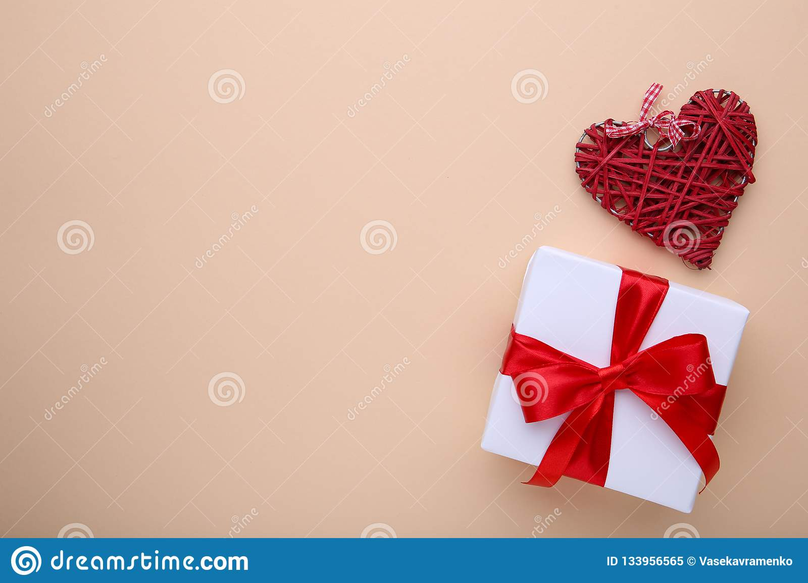 Valentines Day gift with red hearts on beige background
