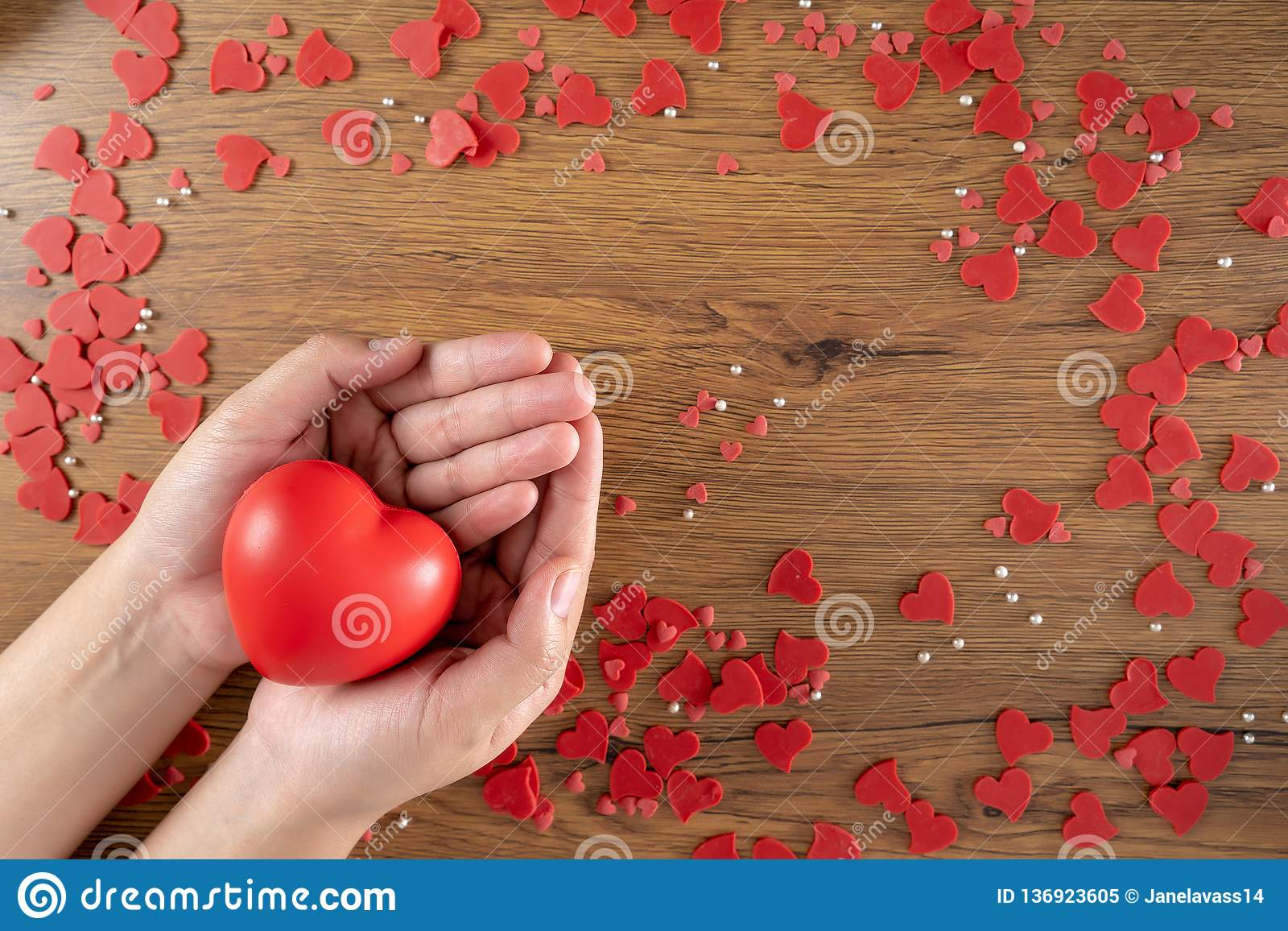 Valentines Day health care love holding red heart and world health day