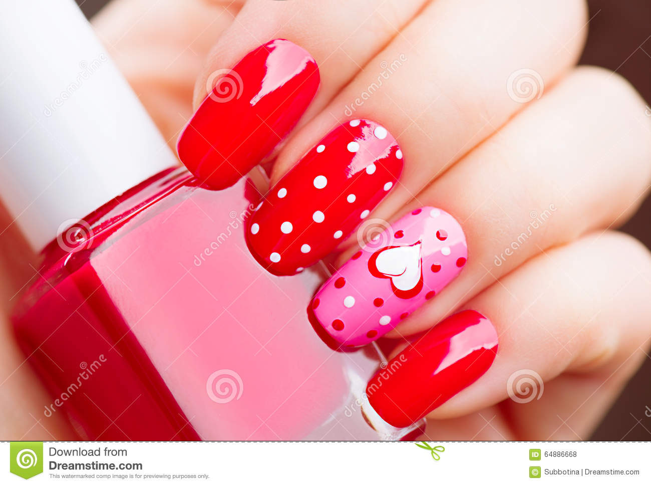 Valentines Day holiday manicure with painted hearts and polka dots