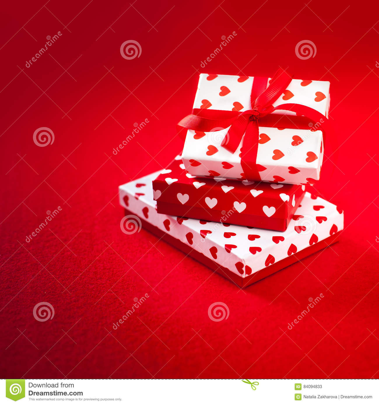 Valentines Day Presents With Hearts And Red Ribbon On Red Backgr ...