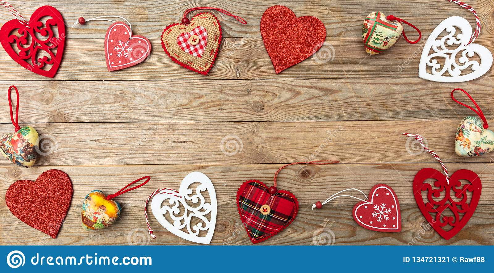 Valentines day. Top view, flat lay of various hearts, wooden background