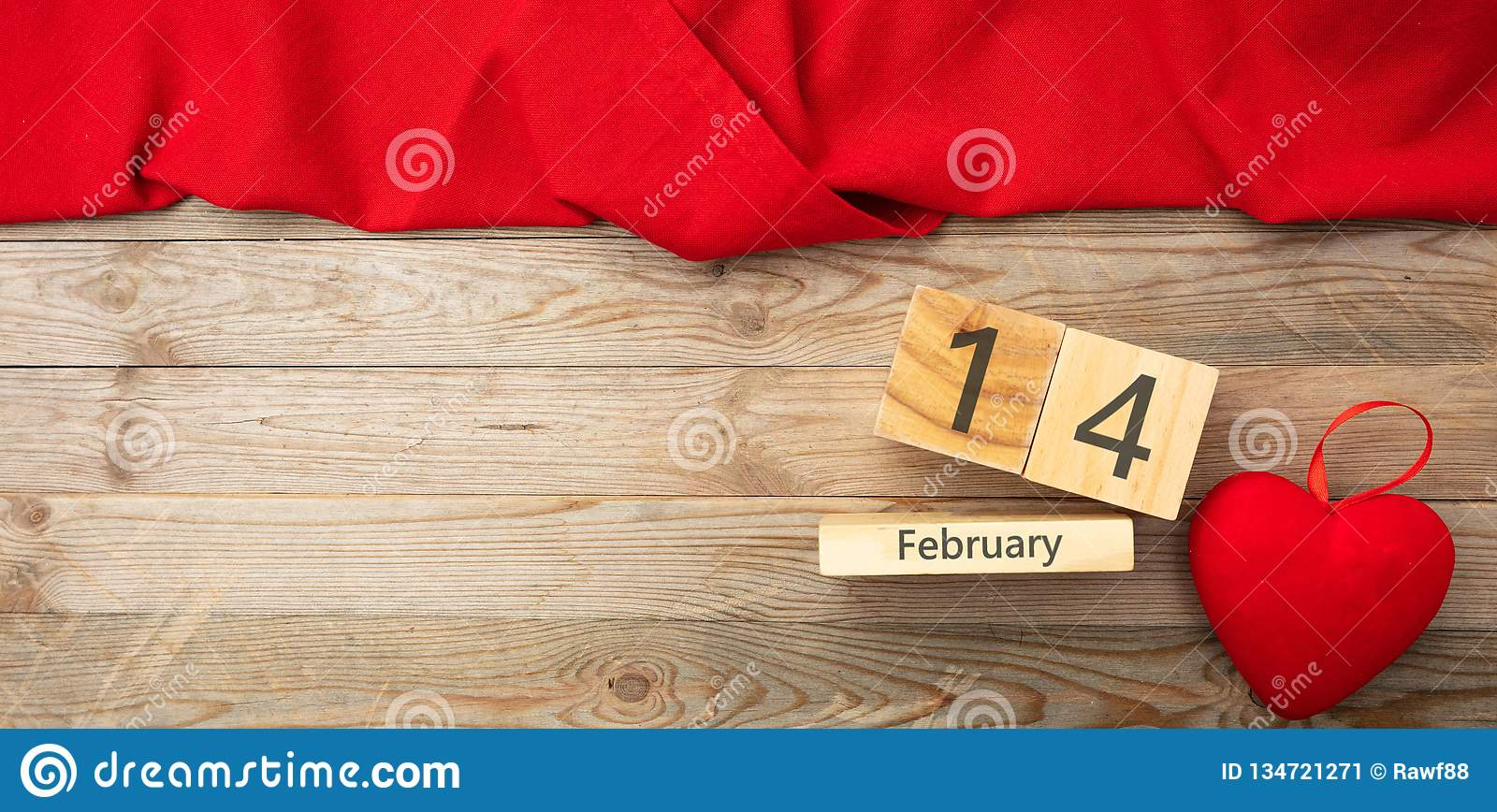 Valentines day. Top view of red heart and calendar date, wooden background