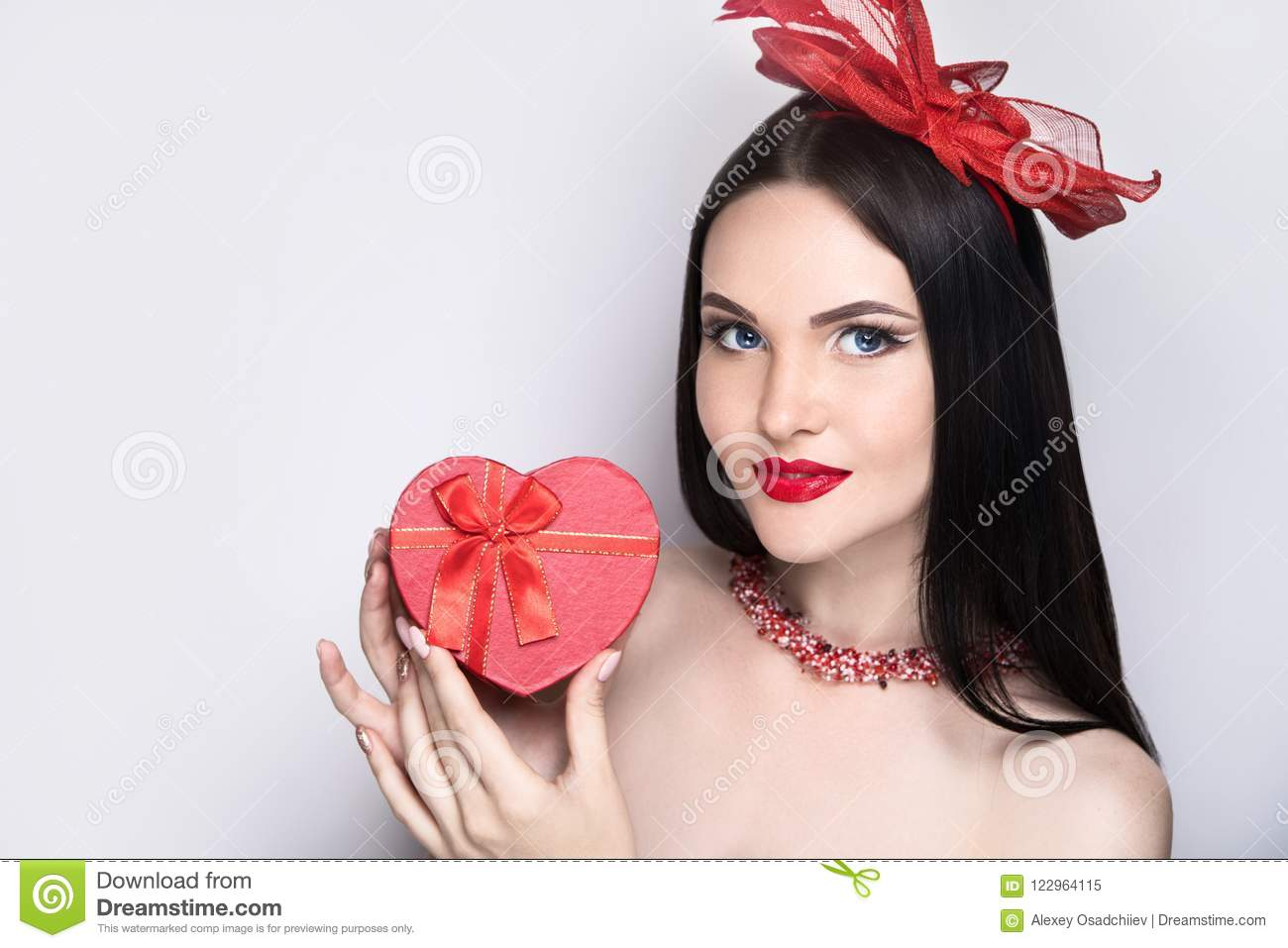 Happy Valentine`s Day card. Loving beautiful girl. Woman in a red hat  holding small heart box. Background horizontal banner ded5044bc4c0