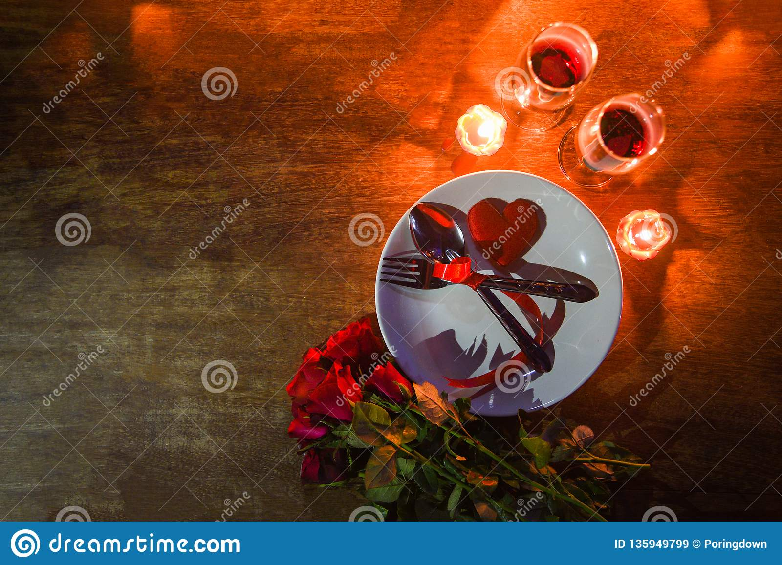 Valentines dinner romantic love conceptRomantic table setting decorated with fork spoon on plate and couple champagne glass wine